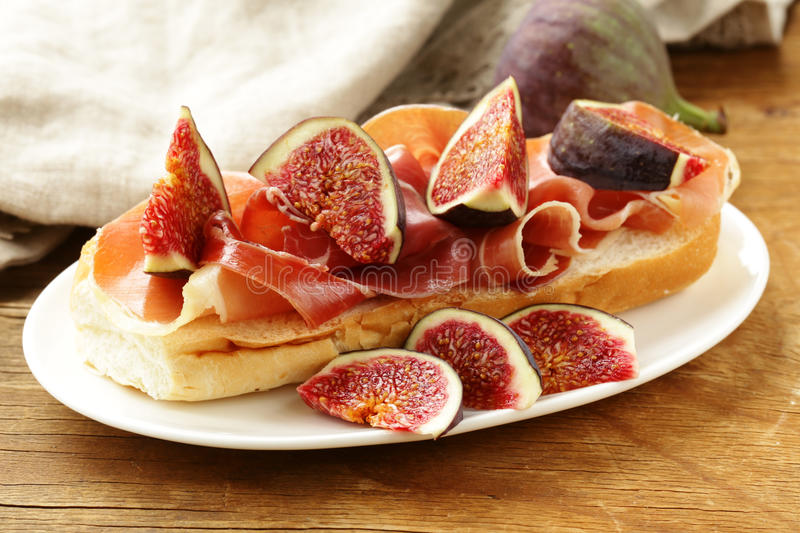 Gourmet sandwich with smoked ham (Parma) and figs stock images