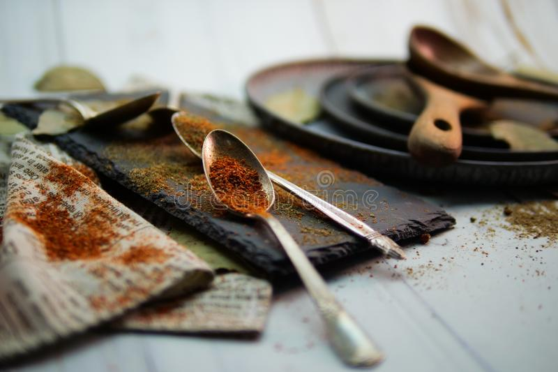 Gourmet spice dishes, spoons, wooden plates. Etc stock images