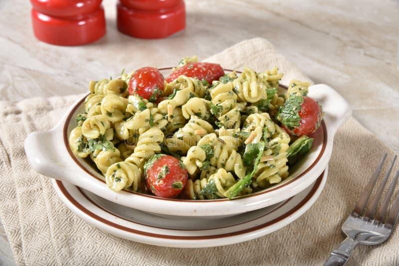 Gourmet spinach pasta salad stock image