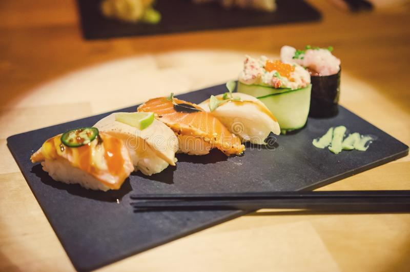 Gourmet sushi selection. Selection of gourmet nigiri sushi on a stone slab- salmon, crab, butterfish, tuna stock images
