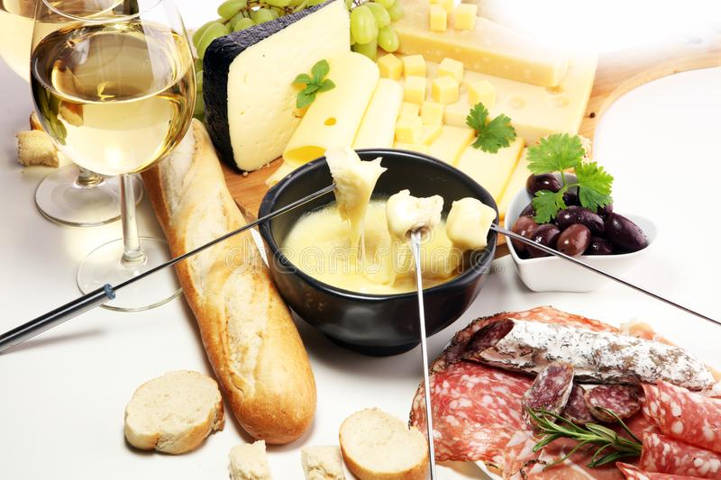 Gourmet Swiss fondue dinner on a winter evening with assorted ch royalty free stock photos