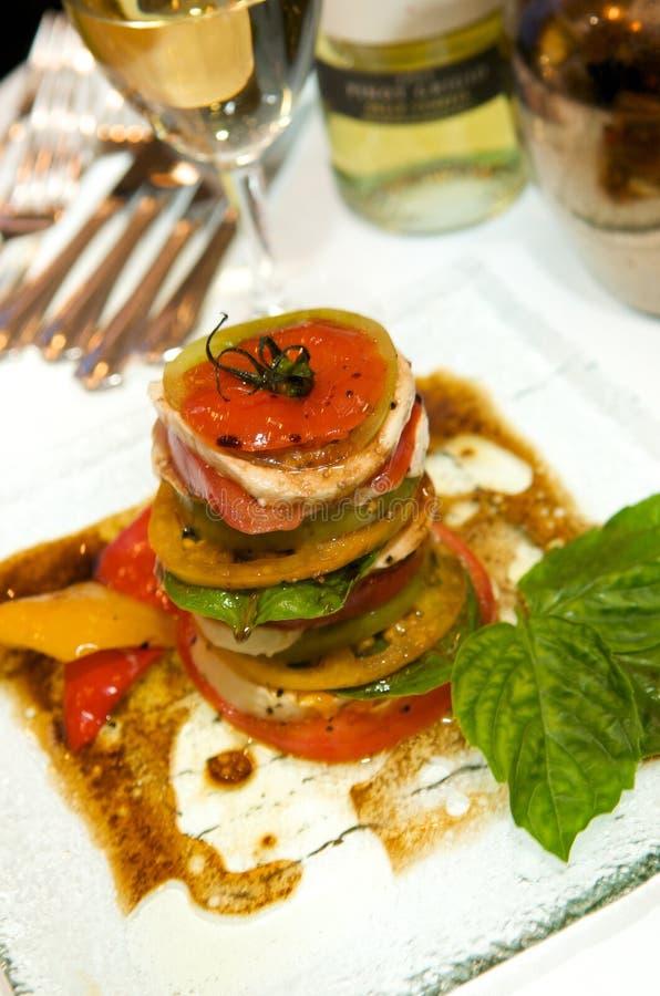 Gourmet tomato mozzarella and basil starter royalty free stock photo