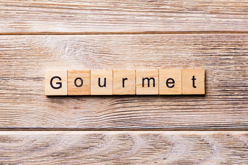 Gourmet word written on wood block. gourmet text on wooden table for your desing, concept.  royalty free stock images