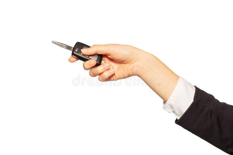 Gousset de clé d'alarme de participation de la main de la femme de la voiture photos libres de droits