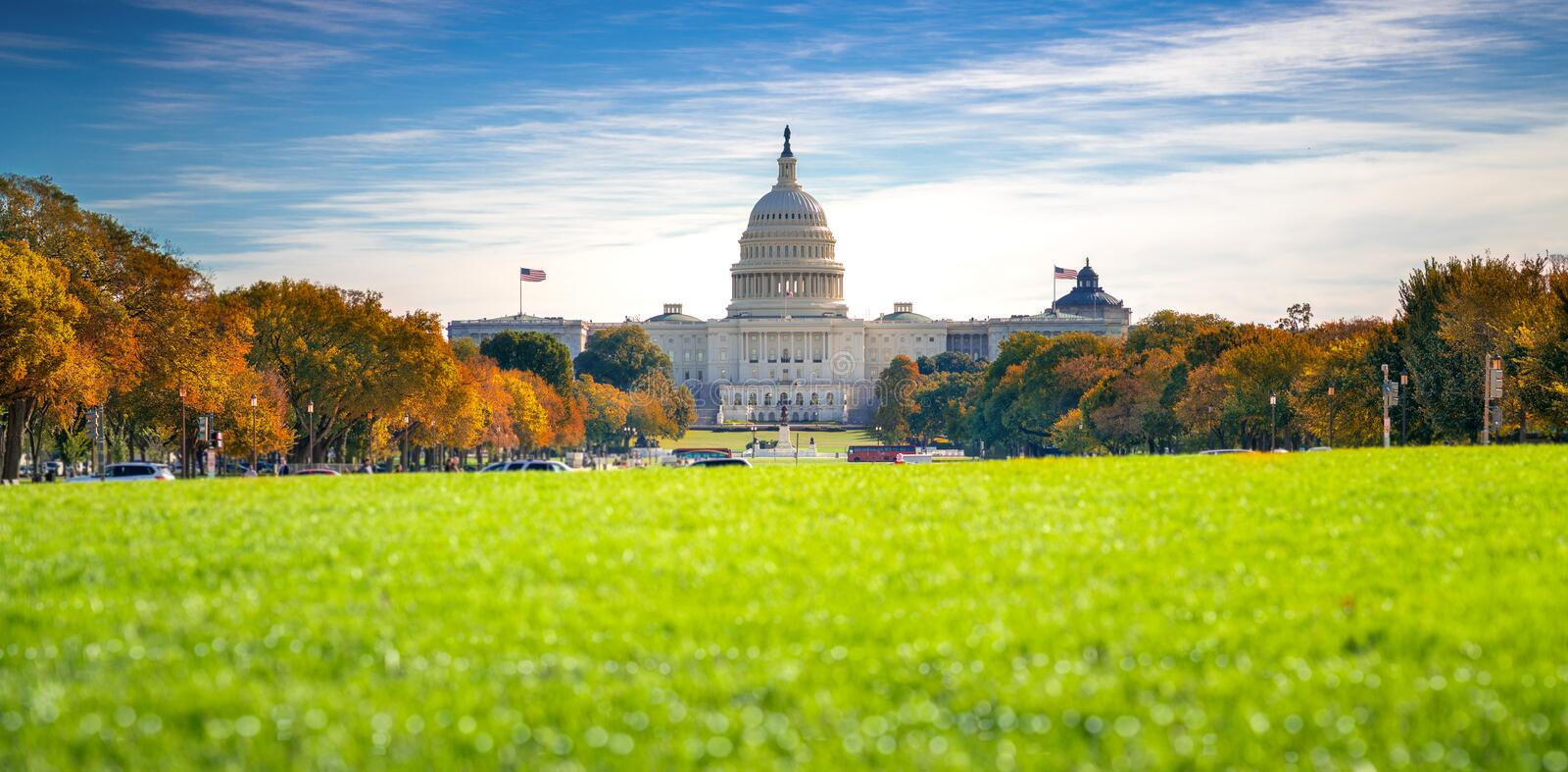 Goverment Capitol building in Washington DC with autumn park stock photography