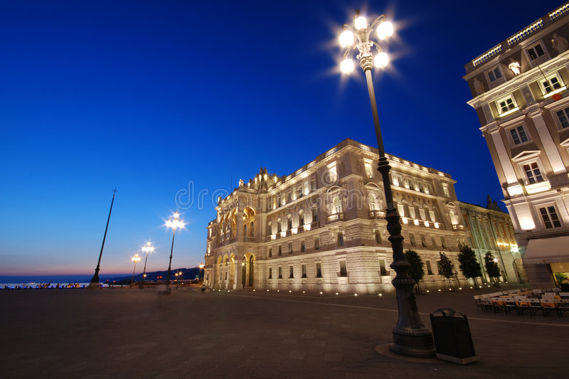 Govern Palace. Piazza Unità d'Italia with illuminated Govern Palace and pole at dusk / night - Trieste - Italy 2007 stock images