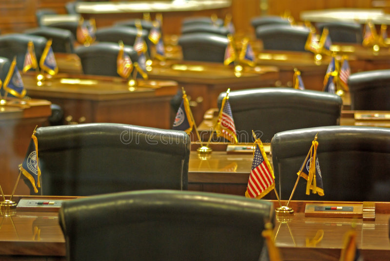 Government. The inside of a government with flags and chairs stock photos