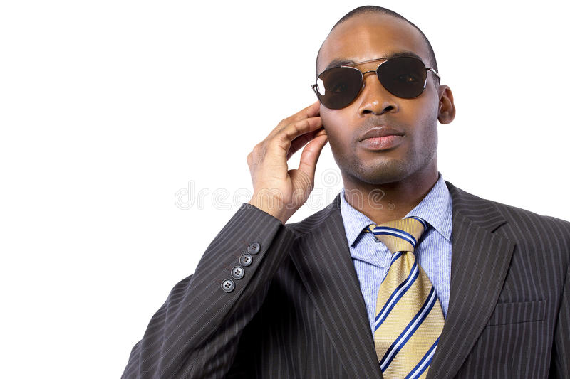 Government Agent. Black male bodyguard wearing sunglasses and black suit royalty free stock photography