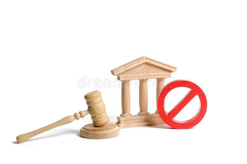 Government or bank building and a red NO symbol with a judge gavel. Cancellation of law or decree. Declaration of default. Or bankruptcy of the bank. The royalty free stock photo