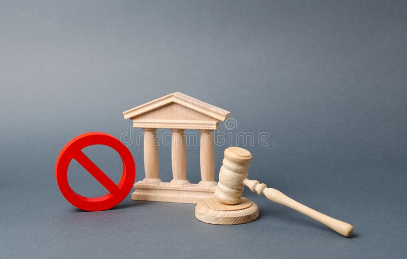 Government or bank building and a red NO symbol with a judge gavel. Declaration of default or bankruptcy of the bank. The adoption stock image