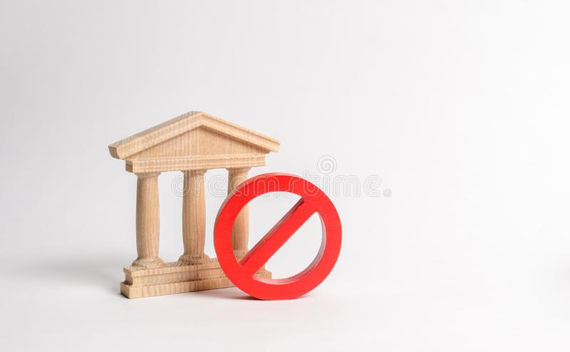 Government building or bank and symbol NO. The concept of prohibiting and restrictive laws. Bans and criminalization, repression. Revocation of a bank license stock photos
