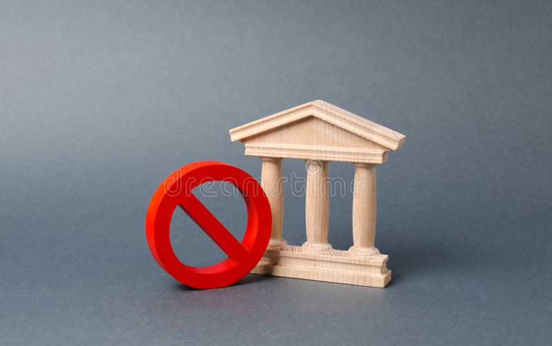 Government building or bank and symbol NO on an gray background. The concept of prohibiting and restrictive laws. Bans and criminalization, repression stock image
