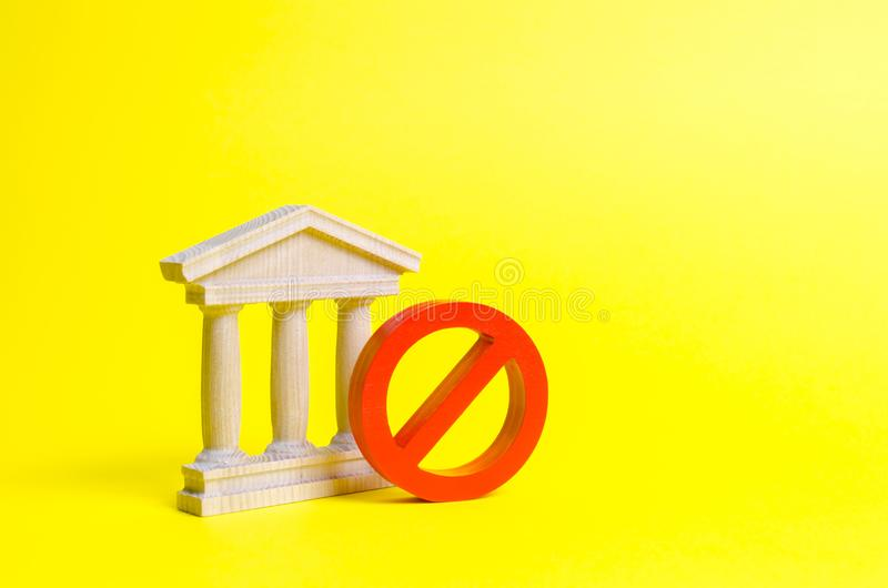 Government building or bank and symbol NO on an yellow background. The concept of prohibiting and restrictive laws. Bans. And criminalization, repression royalty free stock images