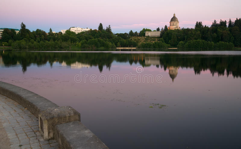 Government Building Capital Lake Olympia Washington Sunset Dusk. The state capital reflects in the lake of the same name at dusk in Olympia, Wa stock images