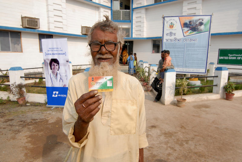 Government Health Scheme Card. An old rural patient holding a government health scheme card under the RashtriyaSwasthyaBimaYojana (RSBY), which is a health stock images
