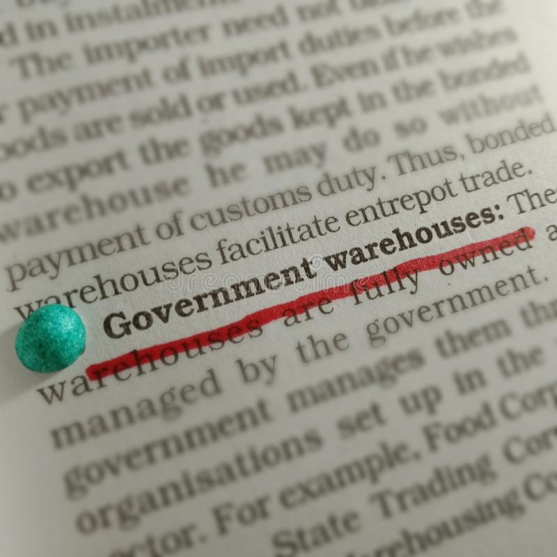 government warehouse text underlined with red colour marker on paper page royalty free stock image