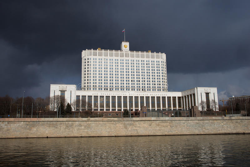 Government White House of the Russian Federation in Moscow. View from riverside rainy day royalty free stock image