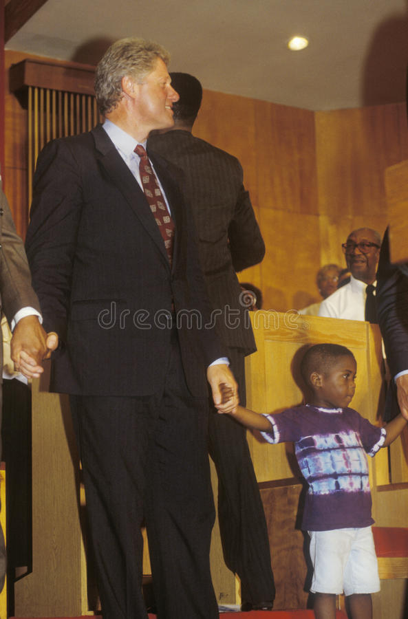 Governor Bill Clinton attends service at the Olivet Baptist Church in Cleveland, Ohio during the Clinton/Gore 1992 Buscapade Great. Lakes campaign tour stock images