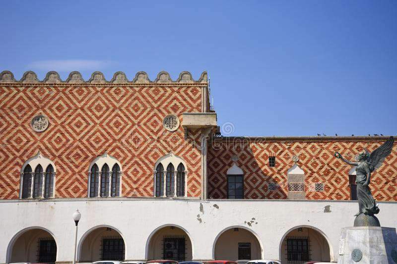 Governors palace on Mandraki Harbour on the island of Rhodes royalty free stock photography