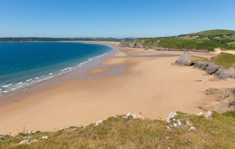 Gower Peninsula kustWales UK populär turist- destination i den sandiga Pobbles för sommar stranden royaltyfri fotografi