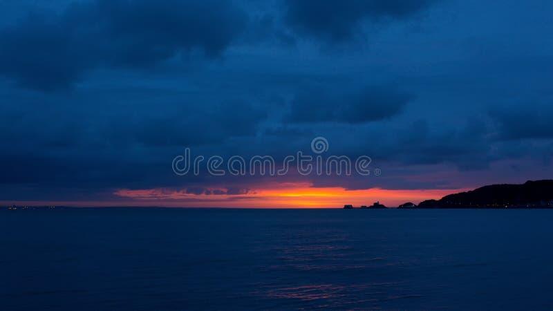 Gower-Sonnenaufgang über Mumbles stockbilder