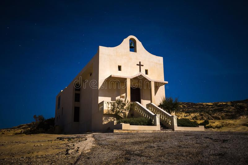 Gozo, Malta - The Saint Anne or Sant` Anna Chapel at Dwejra bay by night on the island of Gozo. At full moon royalty free stock photo