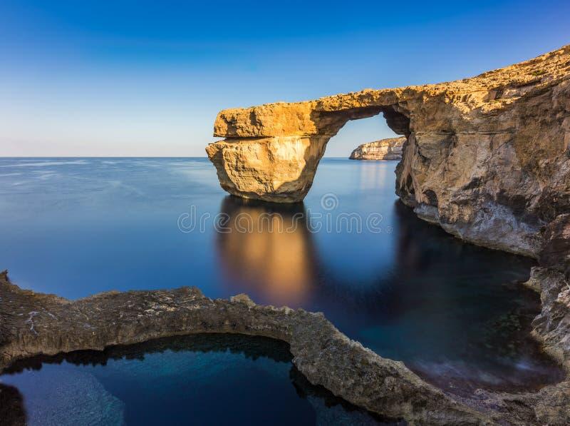 Gozo, Malta - Sunriseat schöne Azure Window stockfotos