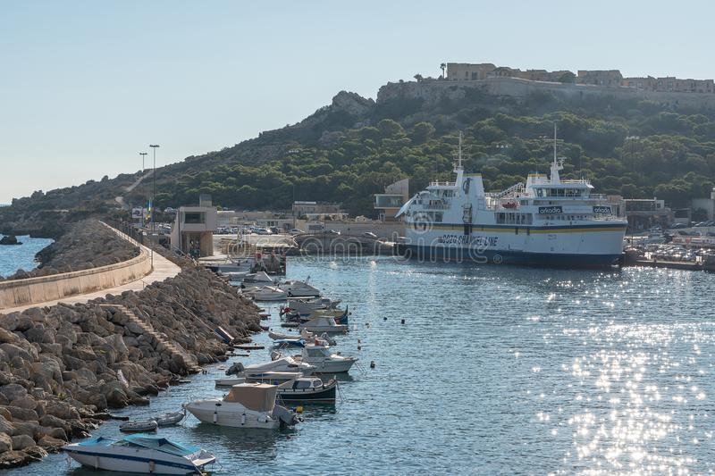 Gozo Mgarr Harbor breakwater. 30th SEP 2018 Mgarr Gozo. Gozo Mgarr Harbor breakwater and another ship moored with chambre fort in view. on a sunny summer day royalty free stock photo