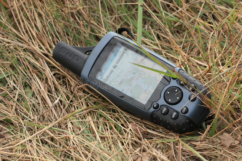 GPS with map. Modern navigation with GPS units. Easy find way and geocaching royalty free stock image