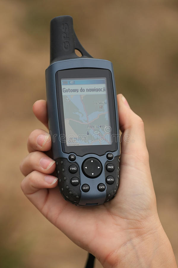 GPS with map. Modern navigation with GPS units. Easy find way and geocaching royalty free stock photography