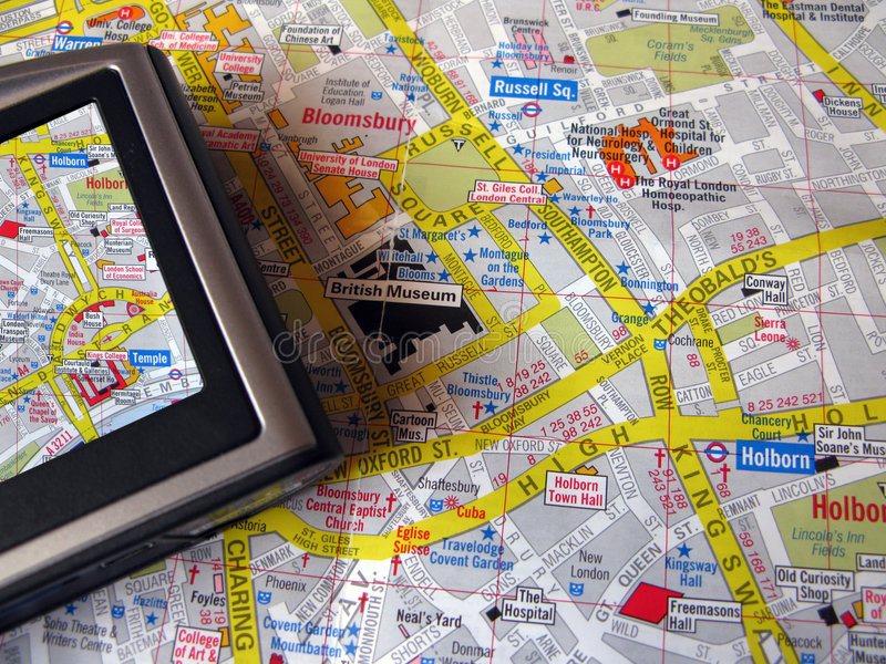 Gps and map. Gps and traditional map confronting stock image