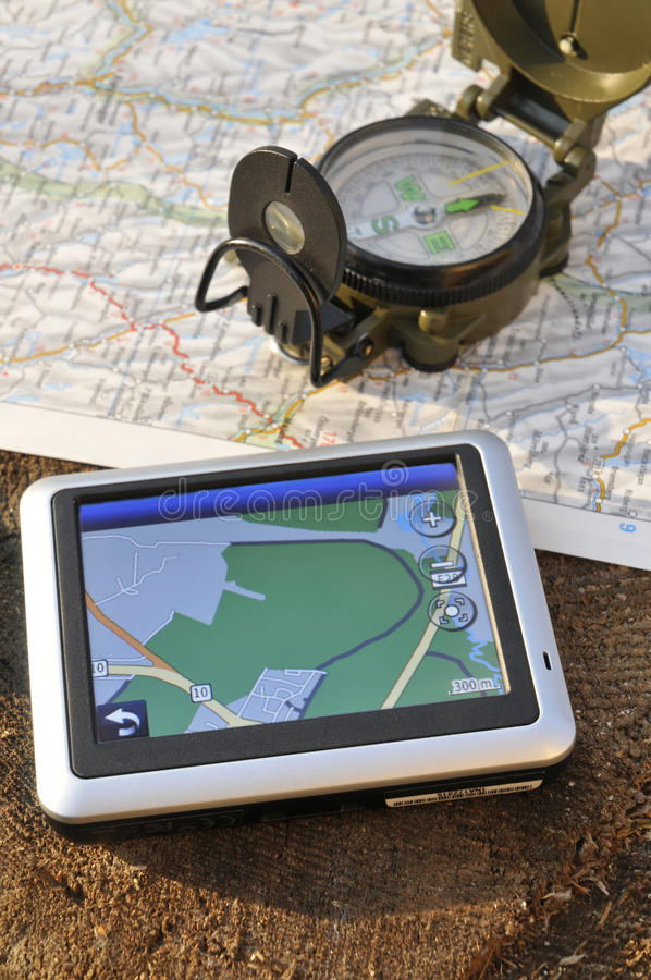 Gps and military compass. Navigation and military compass on the map stock photo
