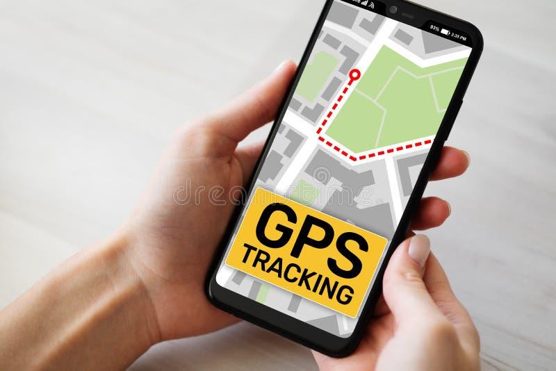 GPS que segue o mapa na tela do smartphone Sistema de navega??o mundial, conceito da navega??o fotografia de stock royalty free