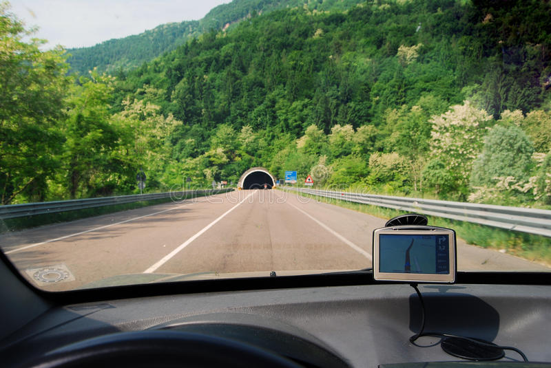 Gps system navigation in car. GPS - Global position solution - Satellite navigation system in use in a car on a road stock photos