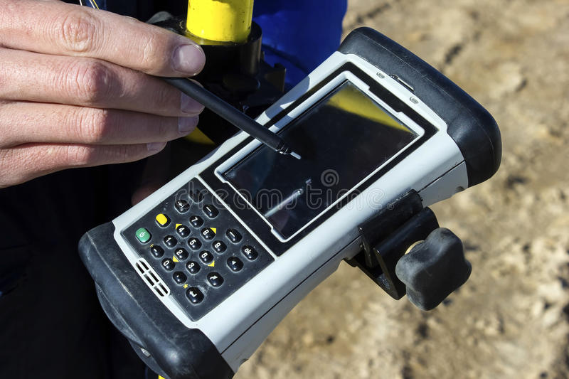 GPS. The tool determines the GPS coordinates on the ground to do the mining stock images