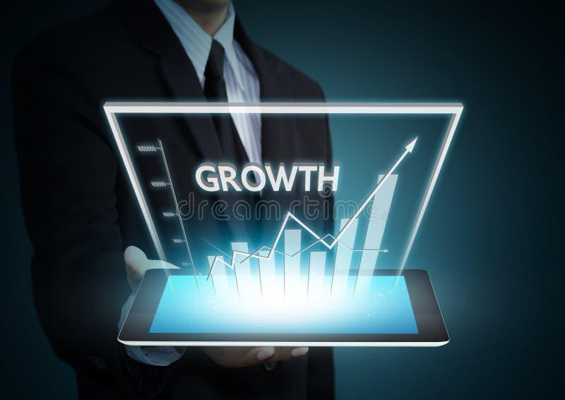 Gráfico del crecimiento en tecnología de la tableta foto de archivo libre de regalías