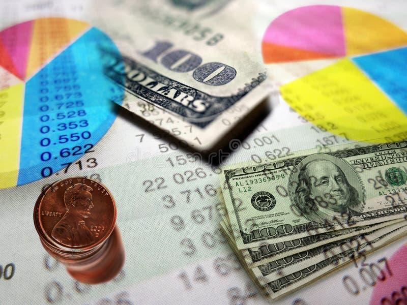 Gráficos y dinero del mercado de acción foto de archivo
