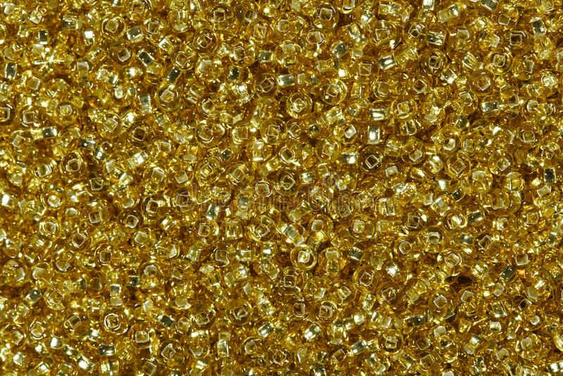 Grânulos amarelos dourados da semente foto de stock