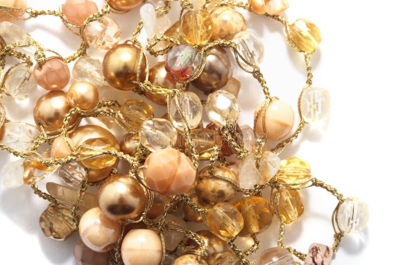 Grânulos dourados e amarelos fotografia de stock royalty free