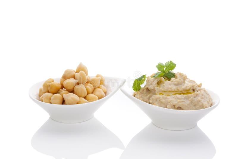 Grãos-de-bico e hummus. fotos de stock royalty free