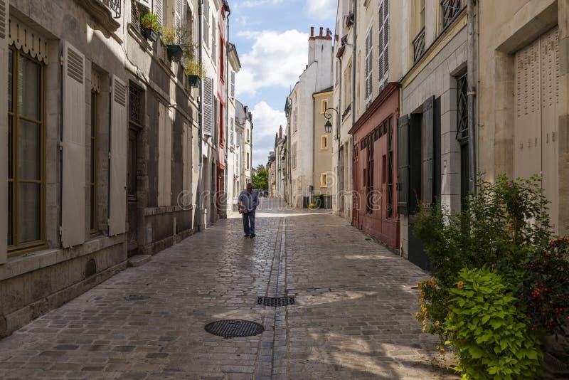 Gränd med mannen i Orleans arkivbilder