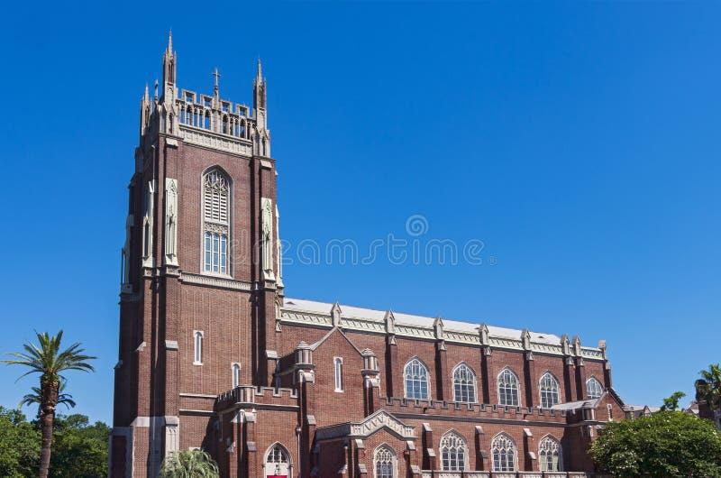 GränsmärkekyrkaKlocka torn och skepp i New Orleans royaltyfri bild