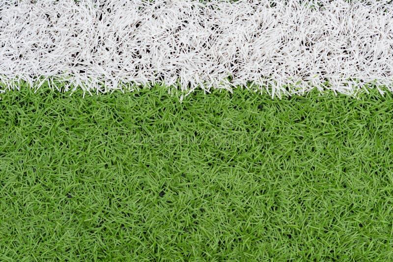 Gräs- och gränslinje på fotbollfält royaltyfri foto