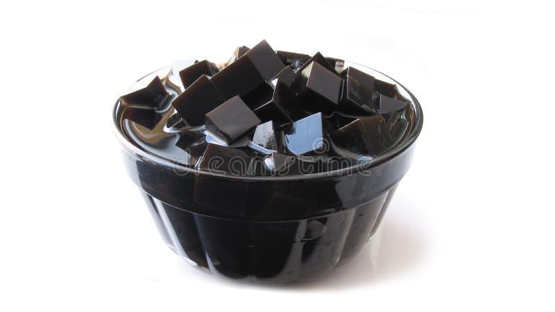 Gräsgeléefterrätt i den glass bunken arkivfoto