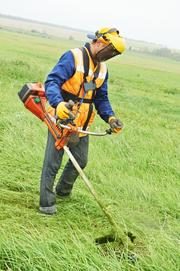 Gräsklipparearbetare royaltyfri fotografi
