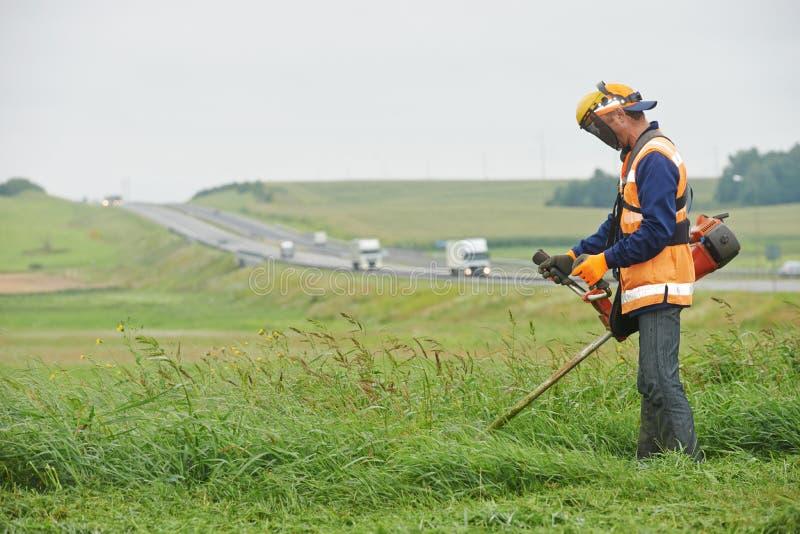 Gräsklipparearbetare arkivfoton