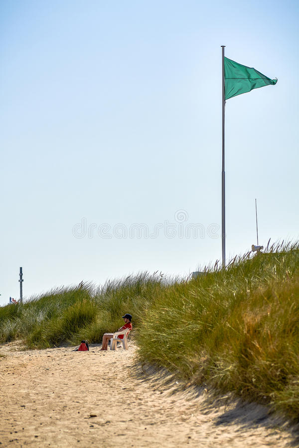 Gräsplan flaggan låter arkivfoton