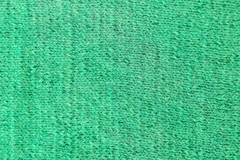 Gräsplan stack woolen textur En prövkopia av sticka för framdel royaltyfri foto