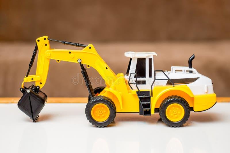 Grävskopa för leksak för barn` s, födelsedaggåva, försäljning och köp av ch arkivbilder