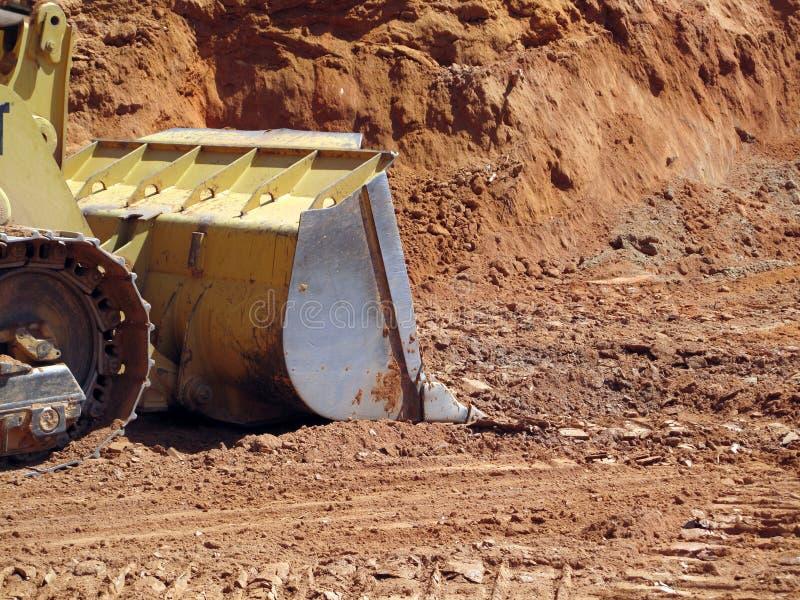 Grävskopa på konstruktionsplats fotografering för bildbyråer